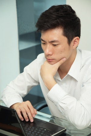 The young chinese businessman concentrate this job photo