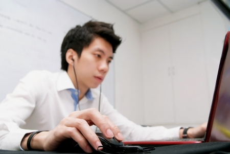 telecommuting: The young chinese businessman concentrate this job Stock Photo