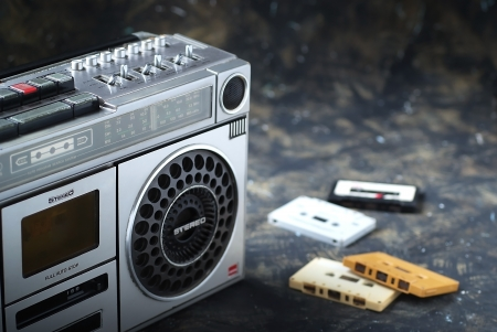 The retro radio with  a cassettes  on dark background