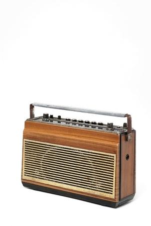 The wooden case retro  radio on white background photo