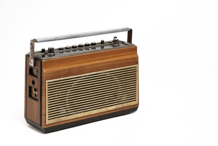 The wooden case retro  radio on white background photo
