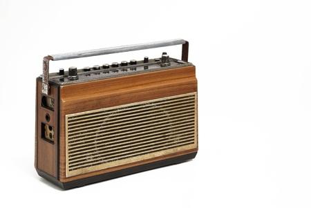 fm: The wooden case retro  radio on white background