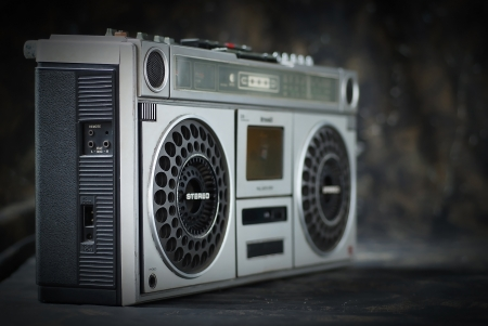 The retro cassette radio on dark background Stock Photo