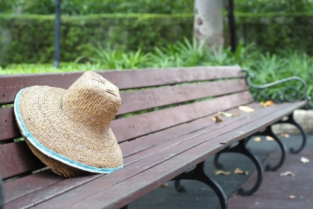 Hat  was placed on a bench in the park. photo