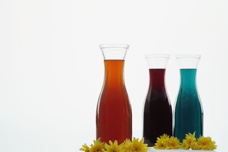 Three colorful herbs juice on white  photo