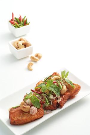 Spicy salmon salad  in Thai style on white Stock Photo - 23011075
