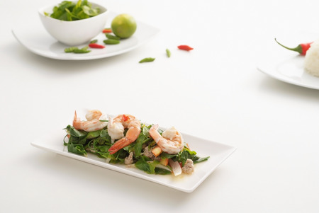 Spicy shrimp salad with warzels on white background