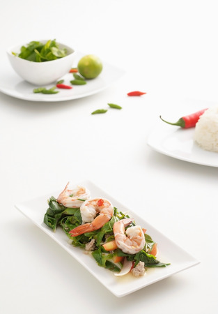 Spicy shrimp salad with  on white background Stock Photo