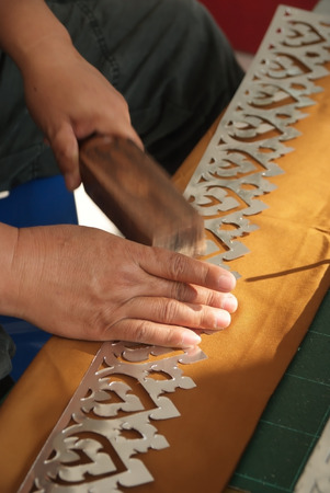 The thai carver is doing a pattern original carving Stock Photo