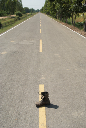 An old boot on the long countryside road