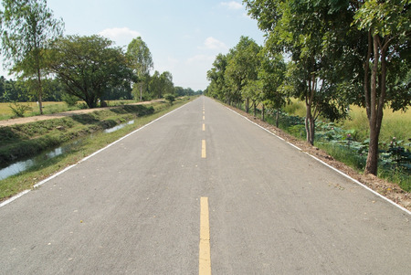 The long empty countryside road in Thailand