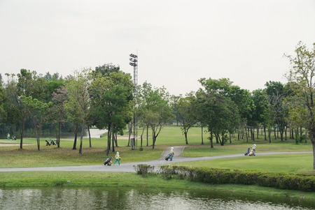 A beautiful golf course with caddies in a nice day