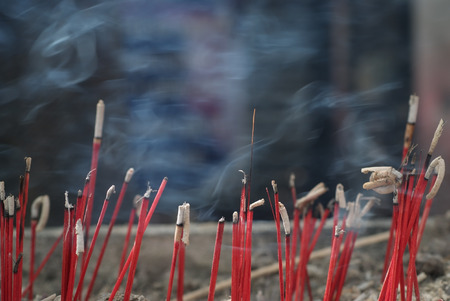 Many incense burning and filled with smoke