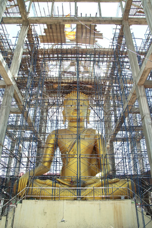 The construction of big golden Buddha in the tower Stock Photo
