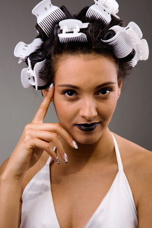 beautiful woman with curlers on head photo