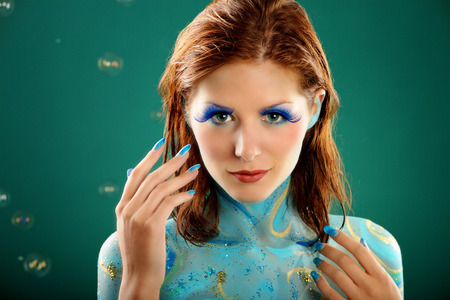 fashion model in Aqua bodypainting photo
