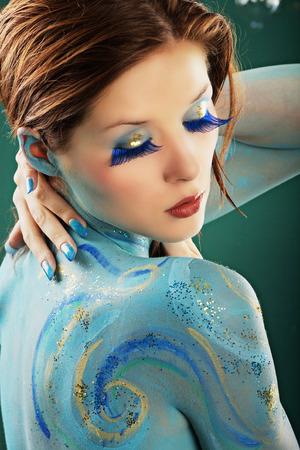 fashion model in Aqua bodypainting photo