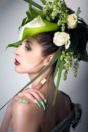 fashion model in green design and flowers