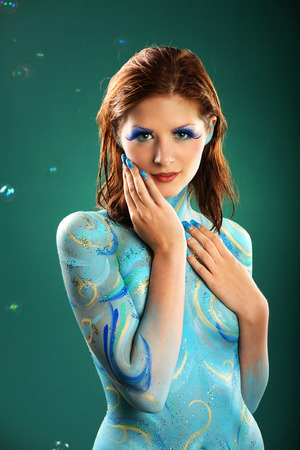 bodypainting: Female fashion model in Aqua body painting Stock Photo