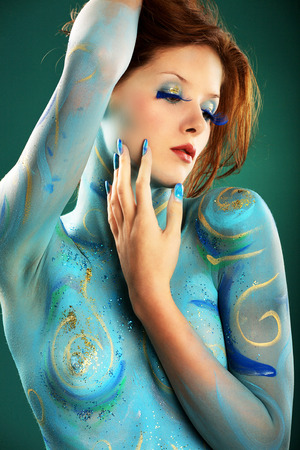 Female fashion model in Aqua body painting photo
