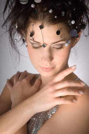 Female fashion model with mirror decor in her hair photo