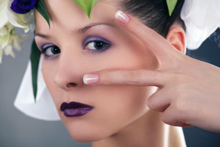model with floral decoration and french nails photo