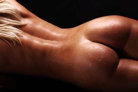 naked women butt and hand view Stock Photo