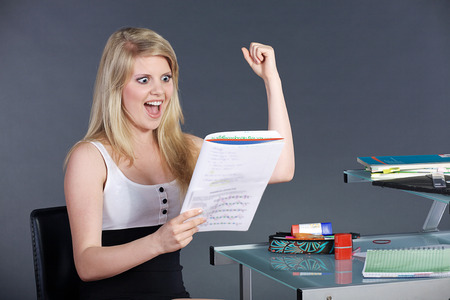 schoolwork: young pretty woman with schoolwork Stock Photo