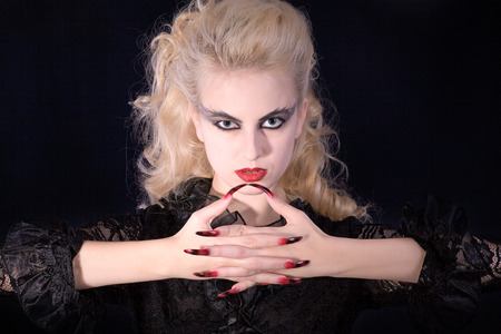 witches model with long airbrush nails photo