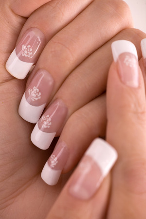 french manicure sexy woman: hands and Nails with french Airbrush design