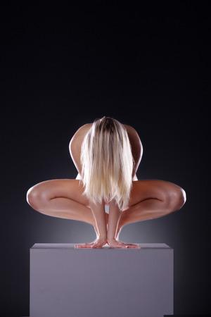naked female body: naked female body on a cube