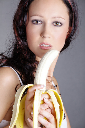 beautiful woman eating a banana photo