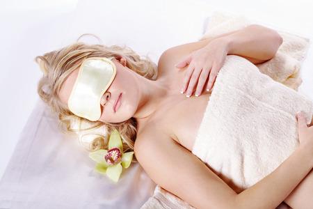 beautiful blond wellness model sleeps with blindfold photo
