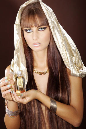 fashion model in cleopatra style and oil photo
