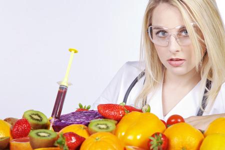 examined: beautiful woman examined many fruits