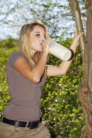 beautiful woman with a bottle of milk photo