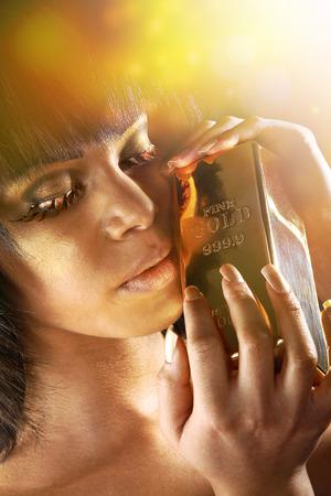 model with fancy eyelashes and bullion photo
