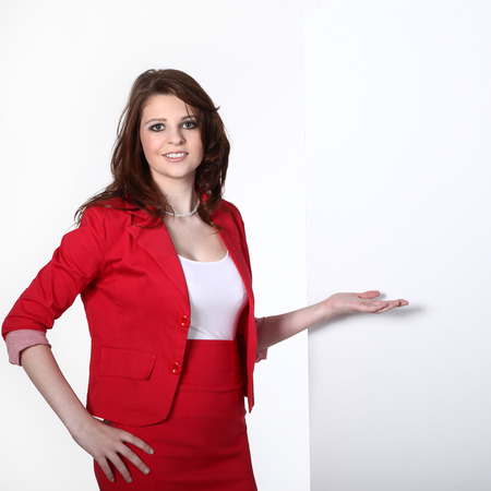 businesswoman pointing at blank space