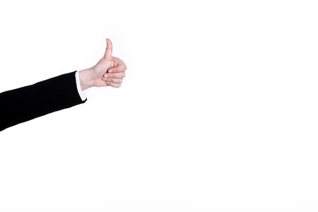 thumps up: Hand sign thumps up on white wall Stock Photo
