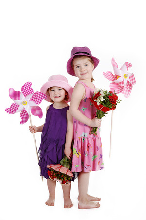 young little girls with flowers and pinwheel photo