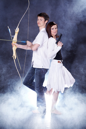 beautiful couple with arrow and Boogen ansd fog photo