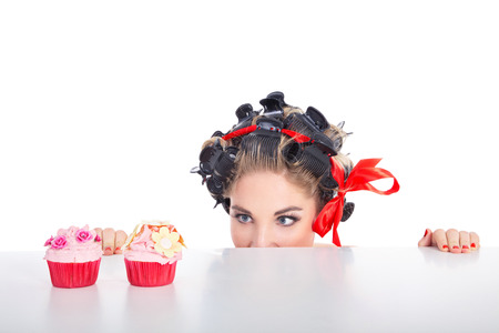 young woman in pin up style and cupcake