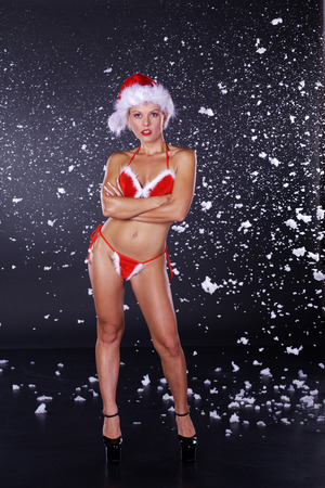 christmas woman in sexy santa claus outfit photo