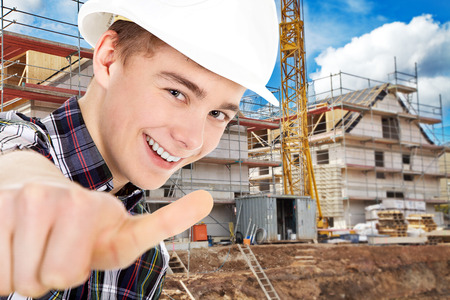 thumps up: construction worker with thumps up Stock Photo