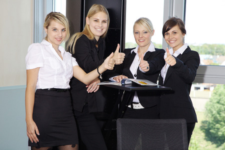 Business women with thump up in Office