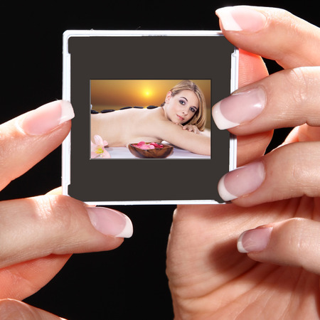 a hand holding a photograph photo