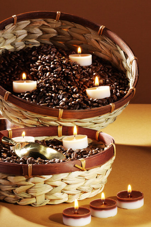 diat product: coffee beans decorated with candles Stock Photo