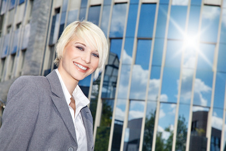 business woman standing in front of the building photo