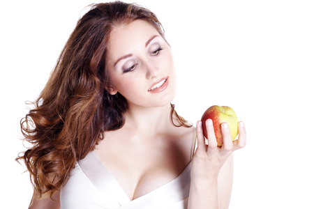 beautiful woman looking at an apple photo