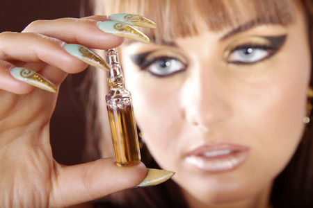 fashion model in cleopatra style and ampoule